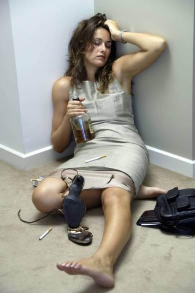 B707KM Woman lies drunk on floor