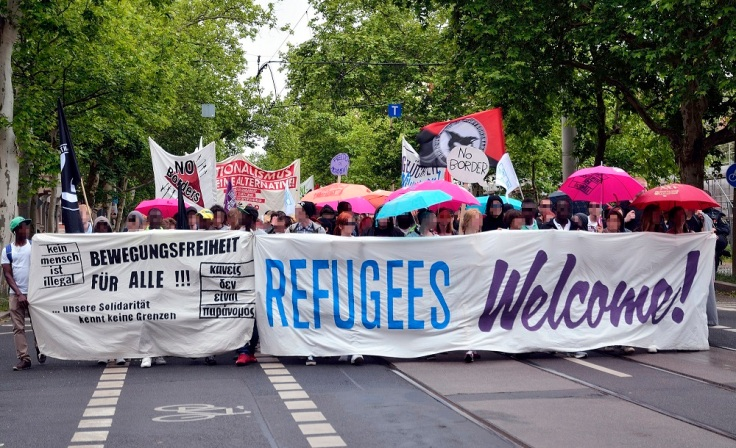 refugees20welcome20sign20germany20credit20caruso20penguin20v1
